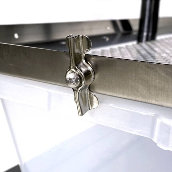 Vision Products rodent rack tub security clip on a rack close up